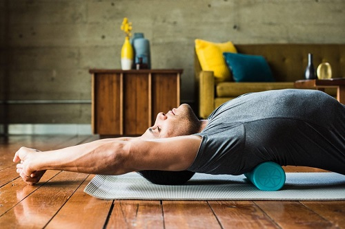 Man Stretching On Foam Roller