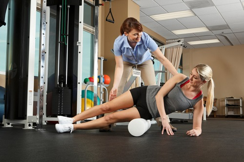 Woman Exercising With Therapist