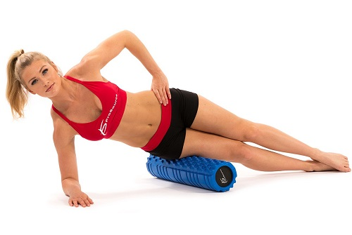 Woman Exercising On Foam Roller